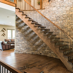 Inspiration for a large and mixed rustic wood curved staircase in Charleston with open risers.