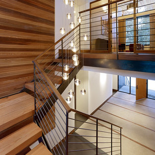 This is an example of a midcentury wood staircase in Sacramento with open risers.