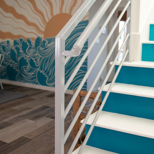 Example of a mid-sized midcentury modern painted straight metal railing staircase design in Other with painted risers