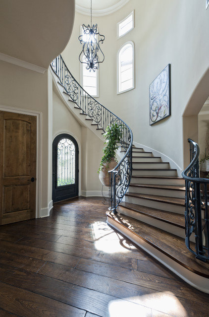 mediterranean staircase by Sullivan, Henry, Oggero and Associates, Inc.