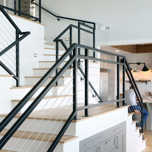Staircase - industrial wooden staircase idea in Raleigh with painted risers
