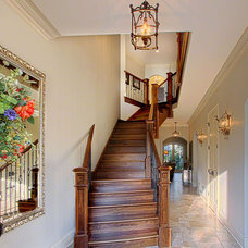 Traditional Staircase by Summit Signature Homes, Inc.