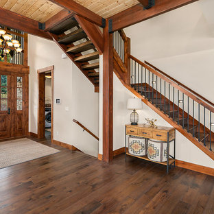 Mountain style wooden l-shaped wood railing staircase photo in Seattle with wooden risers