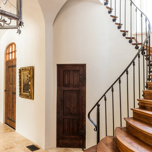This is an example of a mediterranean wood staircase in Dallas with wood risers.