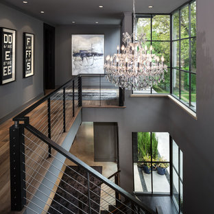 Example of a mid-sized trendy wooden u-shaped staircase design in Dallas