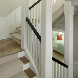 Example of a large transitional carpeted u-shaped staircase design in Grand Rapids with painted risers