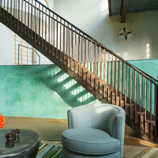Staircase - transitional curved wood railing staircase idea in San Francisco