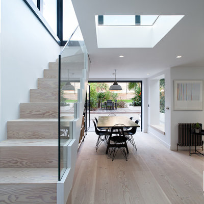 Example of a trendy wooden straight staircase design in London with wooden risers