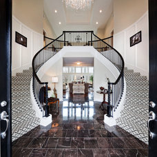 Traditional Staircase by Madi Mali Homes, LLC