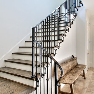 Staircase - transitional wooden metal railing staircase idea in Houston