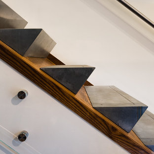 Inspiration for a mid-sized modern concrete l-shaped glass railing staircase remodel in Baltimore with wooden risers