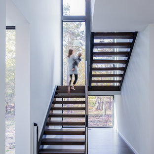 Example of a minimalist wooden u-shaped open staircase design in Charlotte
