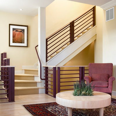 Example of a transitional wooden l-shaped staircase design in Denver with painted risers