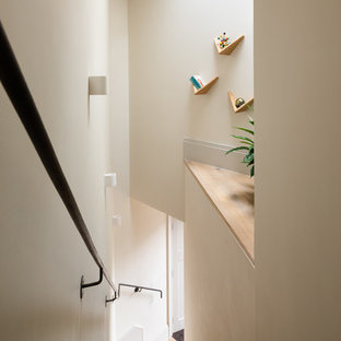 Inspiration for a scandinavian wood metal railing staircase in London.