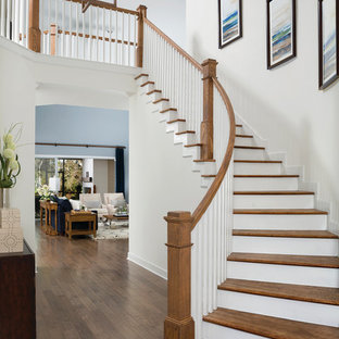 Example of a transitional wooden curved wood railing staircase design in Jacksonville with wooden risers