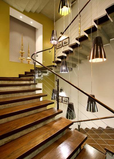 Contemporary Staircase by dipen gada and associates
