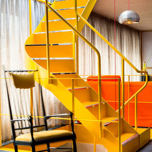 Inspiration for a contemporary metal floating metal railing staircase in London with metal risers.