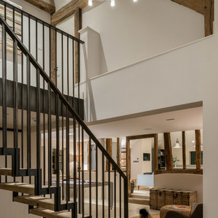 Photo of a medium sized rural wood straight metal railing staircase in Other with open risers.