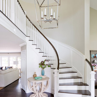 Inspiration for a transitional wooden curved wood railing staircase remodel in Orange County