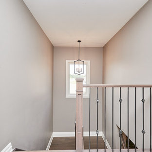 Example of a mid-sized transitional painted metal railing staircase design in Other with painted risers