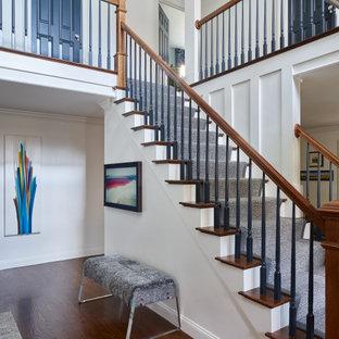 Foto de escalera recta y boiserie, tradicional renovada, grande, con escalones de madera, contrahuellas de madera, barandilla de varios materiales y boiserie
