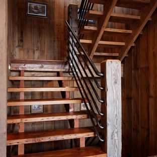 Example of a huge mountain style wooden u-shaped staircase design in Omaha