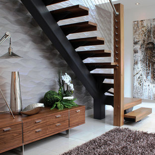This is an example of a contemporary wood l-shaped staircase in Glasgow with open risers.
