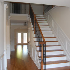 Traditional Staircase by Hurricane Builders, Inc.