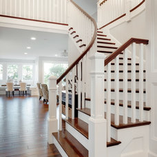 Traditional Staircase by Axiom Luxury Homes