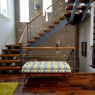 Inspiration for a huge industrial wooden floating open and cable railing staircase remodel in Raleigh