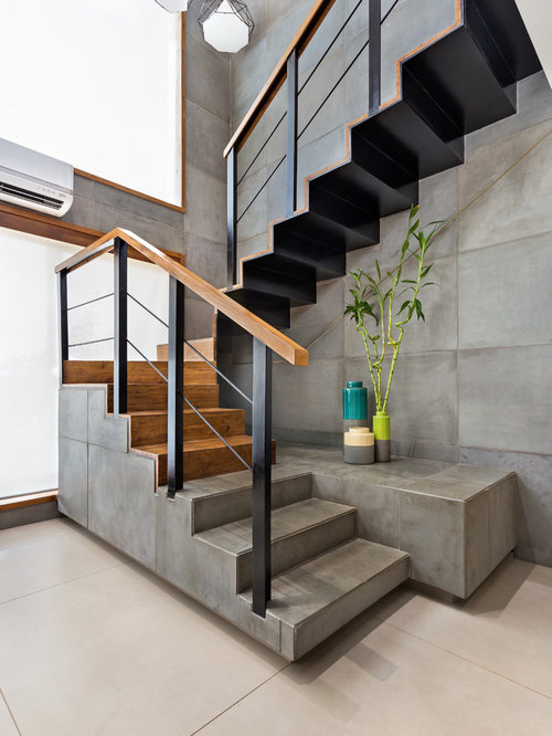 Inspiration For An Industrial Concrete U Shaped Staircase Remodel In Mumbai