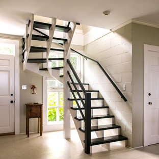 Midcentury modern painted curved open staircase photo in Boston