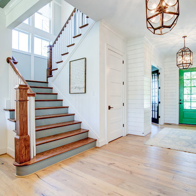 Inspiration for a large country wooden u-shaped wood railing staircase remodel in Richmond with painted risers