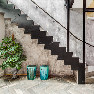 Example of a trendy wooden l-shaped staircase design in London with wooden risers