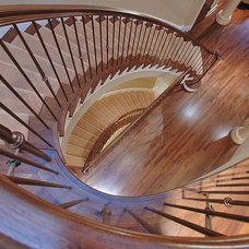 Contemporary Staircase by Erotas Building Corporation