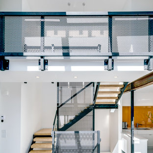 Staircase - industrial wooden u-shaped open and metal railing staircase idea in Calgary