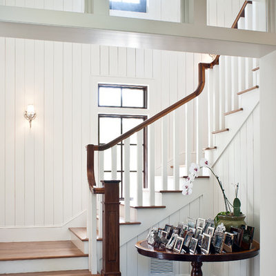 Island style wooden staircase photo in Miami