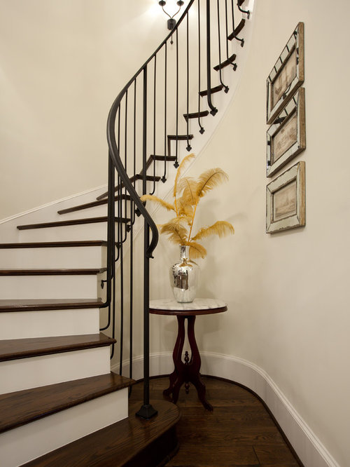 Elegant Wooden Curved Metal Railing Staircase Photo In Houston