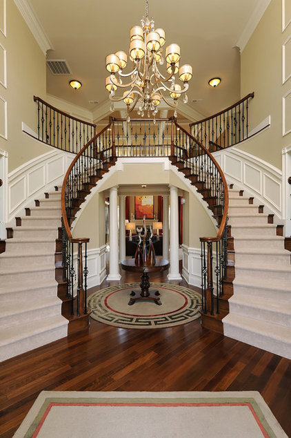 Traditional Staircase by Paula Grace Designs, Inc.