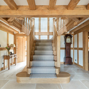 Design ideas for a farmhouse wood staircase in London with wood risers.