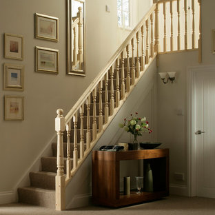 Victorian carpeted straight wood railing staircase with carpeted risers.