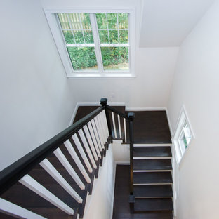 Inspiration for a mid-sized timeless wooden u-shaped staircase remodel in Philadelphia with painted risers