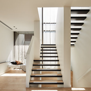 Design ideas for a contemporary wood u-shaped staircase in Melbourne with open risers.