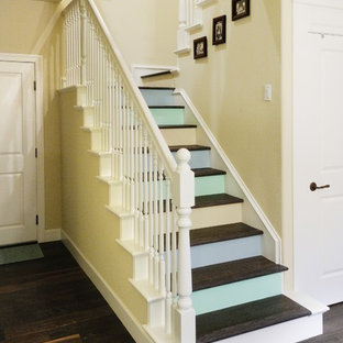 Staircase - mid-sized eclectic wooden u-shaped staircase idea in Sacramento