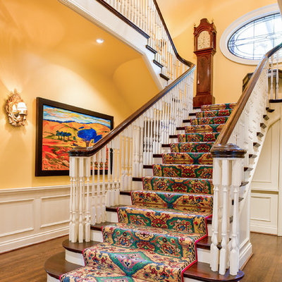Large elegant wooden staircase photo in Toronto with wooden risers