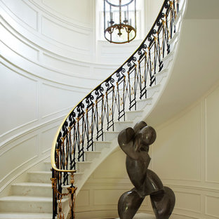 Huge elegant marble curved staircase photo in Miami with marble risers