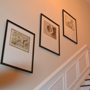 Inspiration for a mid-sized timeless wooden l-shaped staircase remodel in Philadelphia with painted risers