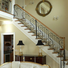 Traditional Staircase by Maynard Studios