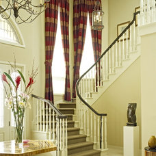 Traditional Staircase by Rossi Knapp Design