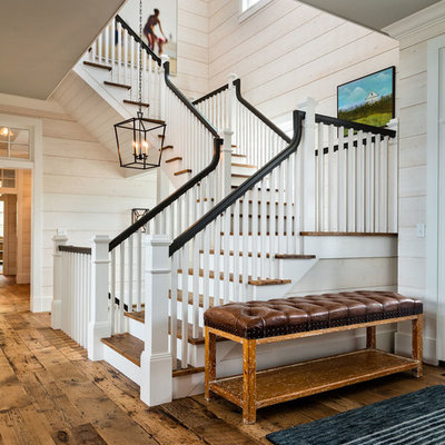 Large cottage wooden u-shaped wood railing staircase photo in Milwaukee with painted risers